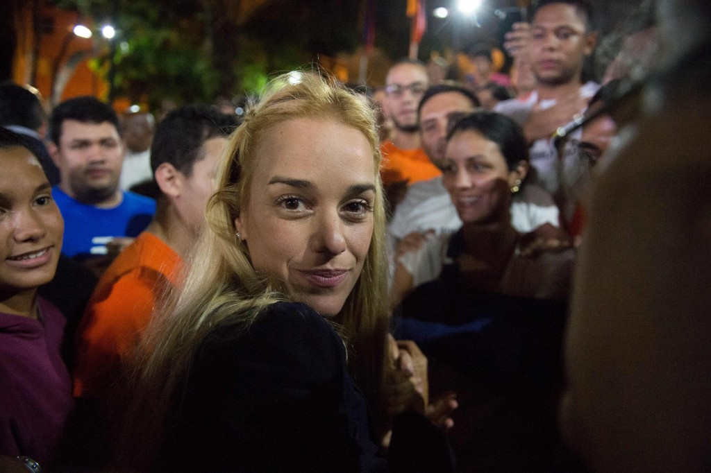 The wife of jailed opposition leader Leopoldo Lopez, Lilian Tintori, arrives at a press conference  in Caracas on September 10, 2015. Jailed Venezuelan opposition leader Leopoldo Lopez was sentenced to nearly 14 years in prison for inciting violence during deadly protests in 2014. The popular dissident, a US-trained economist who has been held at a military prison since February 2014, is accused of inciting violence against the government of President Nicolas Maduro and attempting to force his ouster. AFP PHOTO/ FEDERICO PARRA