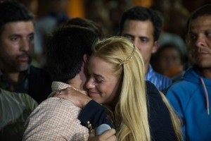 The wife of jailed opposition leader Leopoldo Lopez, Lilian Tintori, greets a supporters before speaking to the press in Caracas on September 10, 2015. Jailed Venezuelan opposition leader Leopoldo Lopez was sentenced to nearly 14 years in prison for inciting violence during deadly protests in 2014. The popular dissident, a US-trained economist who has been held at a military prison since February 2014, is accused of inciting violence against the government of President Nicolas Maduro and attempting to force his ouster. AFP PHOTO/ FEDERICO PARRA