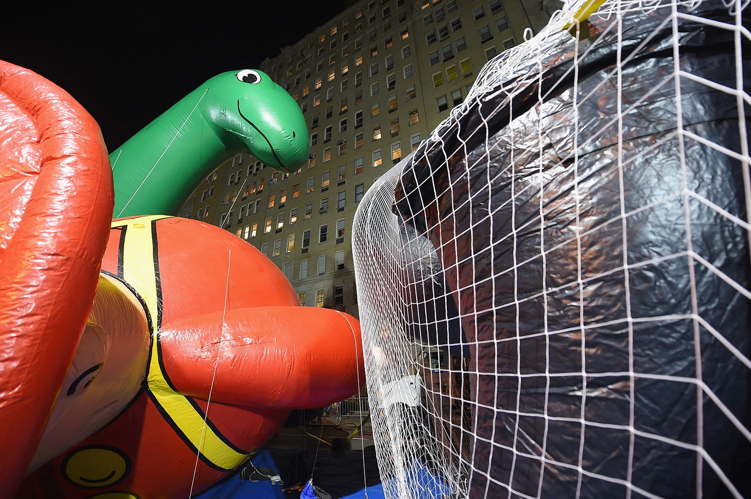 NEW YORK, NY - NOVEMBER 25: General view of the Dino and Harold the Fireman balloons during the 89th Annual Macy's Thanksgiving Day Inflation Eve on November 25, 2015 in New York City. Michael Loccisano/Getty Images/AFP