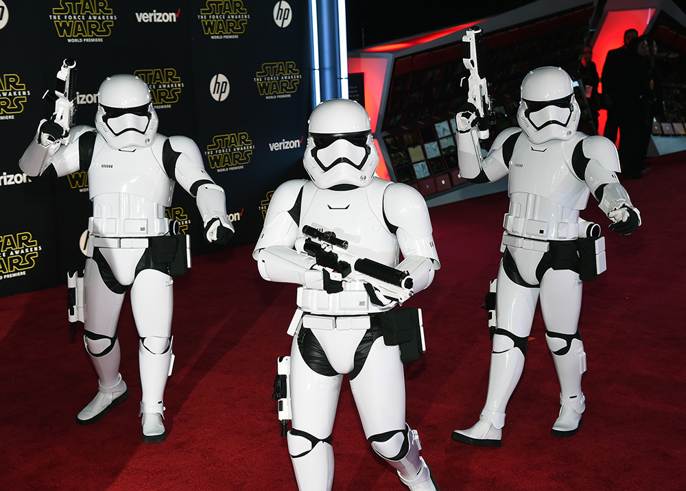 """HOLLYWOOD, CA - DECEMBER 14: Stormtrooper characters walk down the red carpet at the premiere of Walt Disney Pictures and Lucasfilm's """"Star Wars: The Force Awakens"""" at the Dolby Theatre on December 14, 2015 in Hollywood, California. Ethan Miller/Getty Images/AFP"""