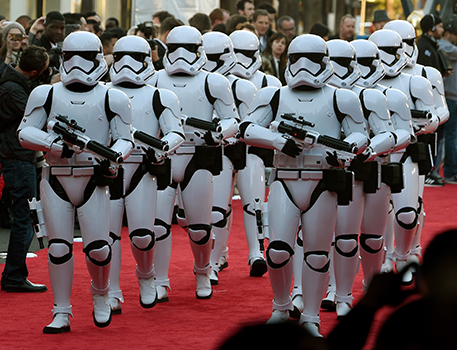 """HOLLYWOOD, CA - DECEMBER 14: Stormtrooper characters march down the red carpet at the premiere of Walt Disney Pictures and Lucasfilm's """"Star Wars: The Force Awakens"""" at the Dolby Theatre on December 14, 2015 in Hollywood, California. Ethan Miller/Getty Images/AFP"""