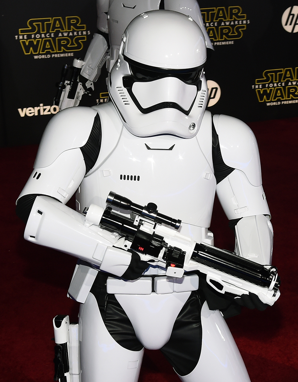 """HOLLYWOOD, CA - DECEMBER 14: A stormtrooper character walks down the red carpet at the premiere of Walt Disney Pictures and Lucasfilm's """"Star Wars: The Force Awakens"""" at the Dolby Theatre on December 14, 2015 in Hollywood, California. Ethan Miller/Getty Images/AFP"""