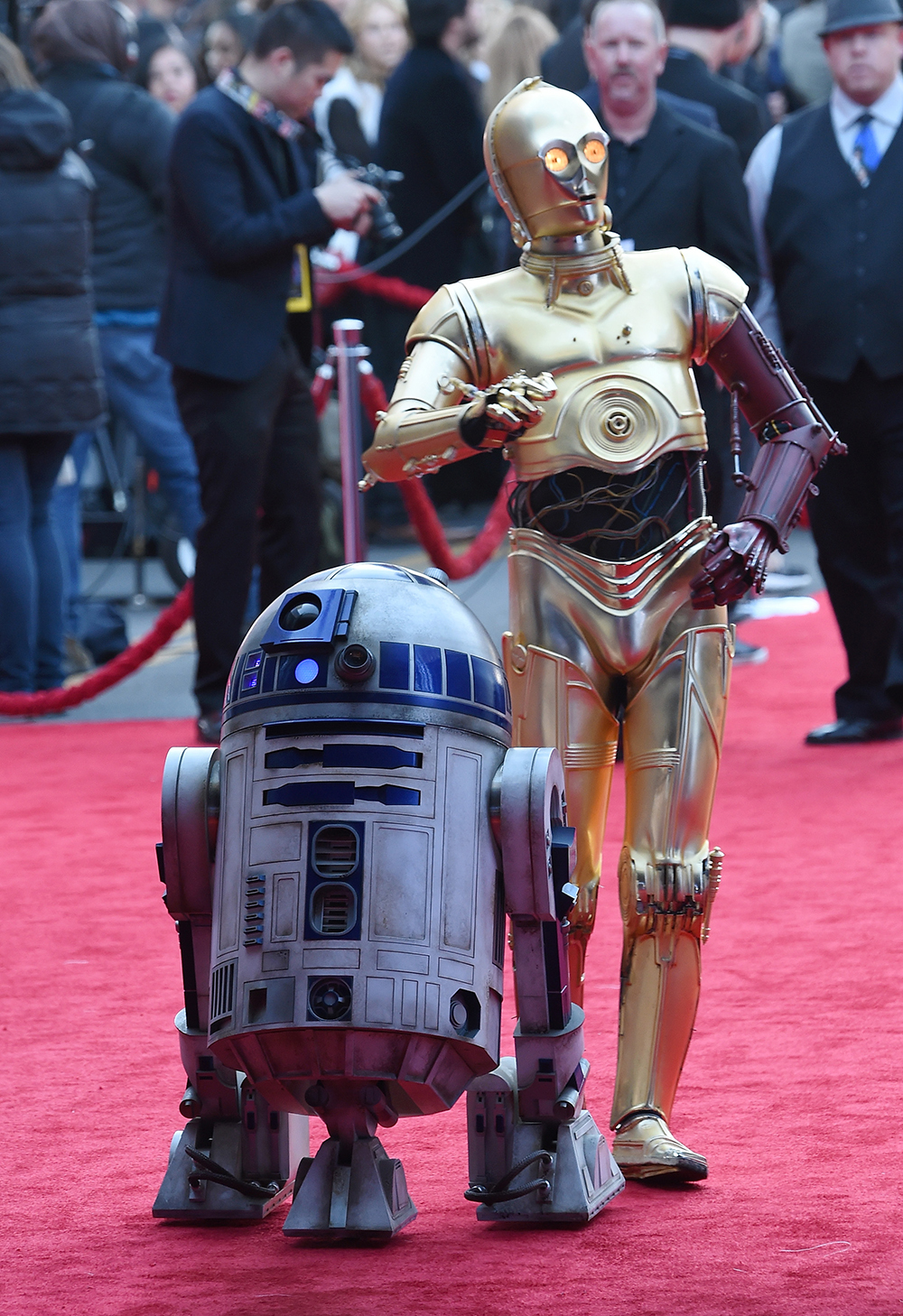 """HOLLYWOOD, CA - DECEMBER 14: R2-D2 (L) and C-3PO characters arrive at the premiere of Walt Disney Pictures and Lucasfilm's """"Star Wars: The Force Awakens"""" at the Dolby Theatre on on December 14, 2015 in Hollywood, California. Ethan Miller/Getty Images/AFP"""