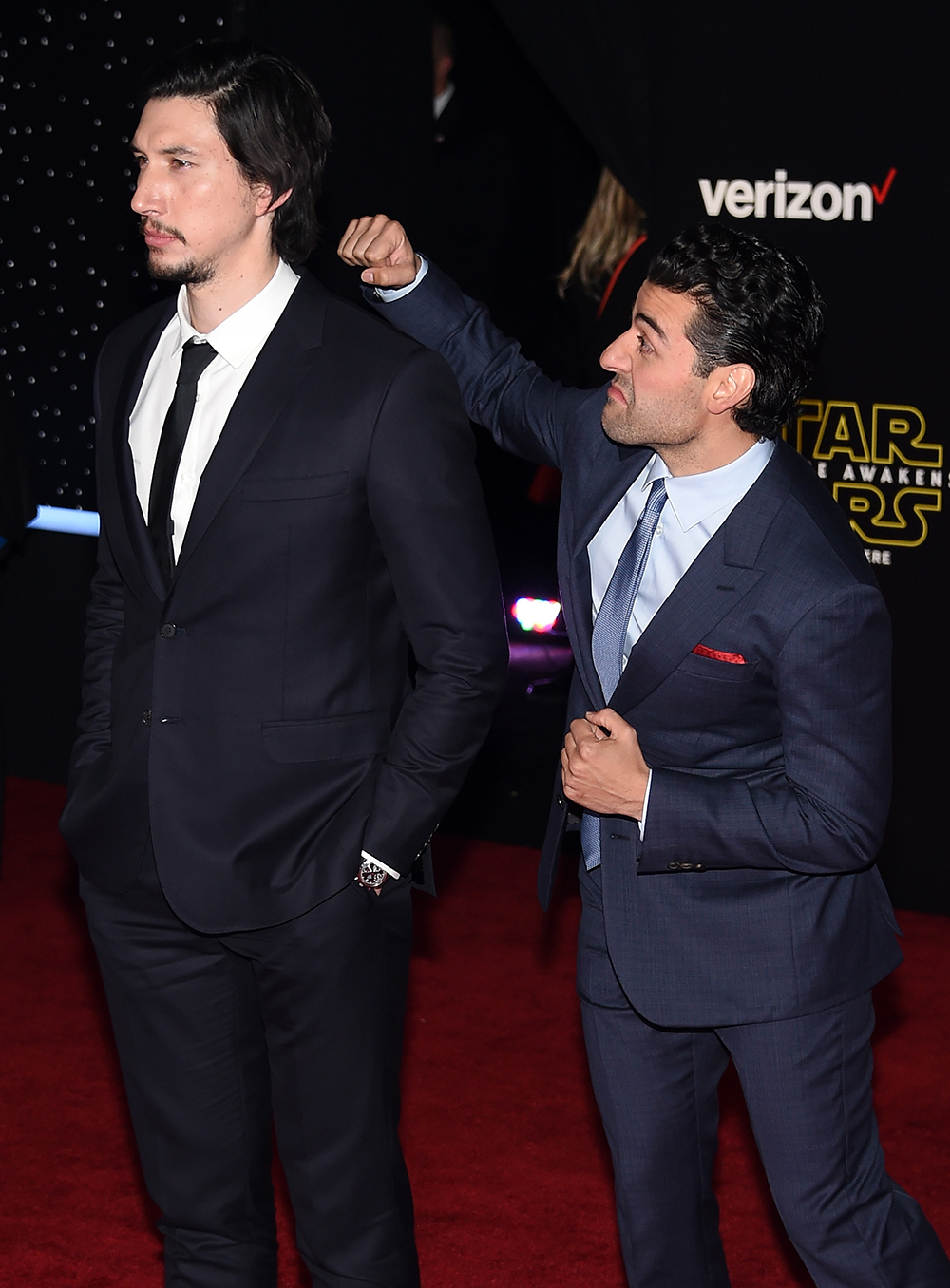 """HOLLYWOOD, CA - DECEMBER 14: Actor Adam Driver (L) is photobombed by actor Oscar Isaac as they attend the premiere of Walt Disney Pictures and Lucasfilm's """"Star Wars: The Force Awakens"""" at the Dolby Theatre on December 14, 2015 in Hollywood, California. Ethan Miller/Getty Images/AFP"""