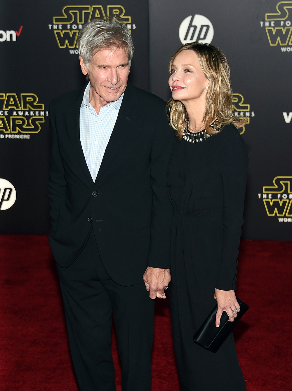 """HOLLYWOOD, CA - DECEMBER 14: Actor Harrison Ford (L) and actress Calista Flockhart attend the premiere of Walt Disney Pictures and Lucasfilm's """"Star Wars: The Force Awakens"""" at the Dolby Theatre on December 14, 2015 in Hollywood, California. Ethan Miller/Getty Images/AFP"""