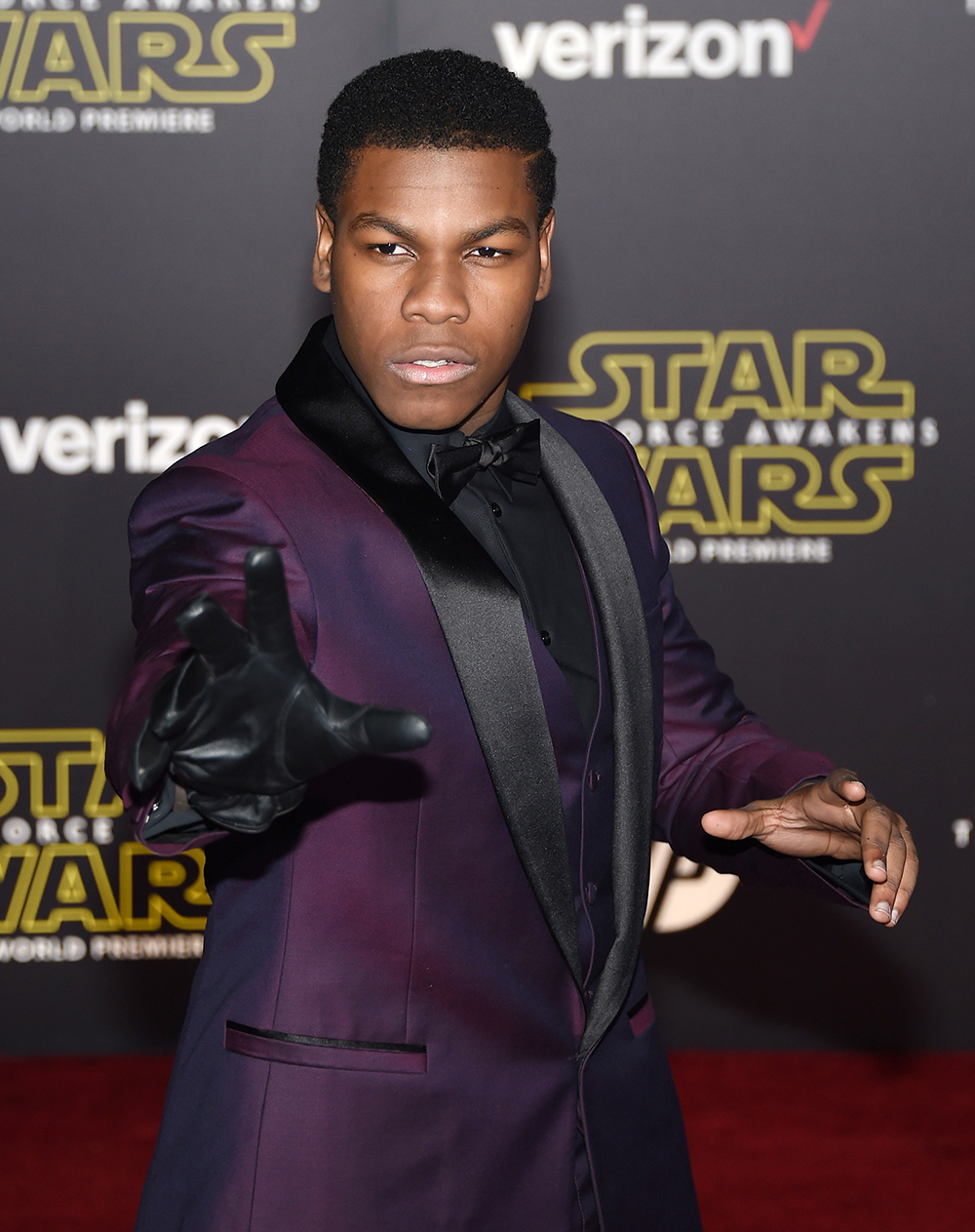 """HOLLYWOOD, CA - DECEMBER 14: Actor John Boyega attends the premiere of Walt Disney Pictures and Lucasfilm's """"Star Wars: The Force Awakens"""" at the Dolby Theatre on December 14, 2015 in Hollywood, California. Ethan Miller/Getty Images/AFP"""